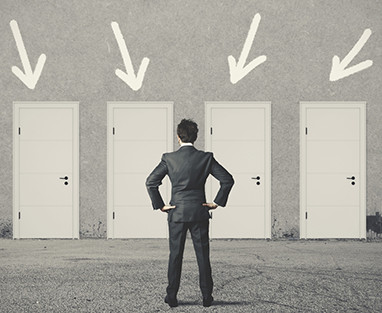 Businessman deciding which door to use